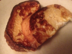 2 pieces of scrumptious french toast, golden brown